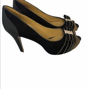 Salvatore Ferragamo black and gold pumps